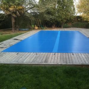 Bache piscine rigide